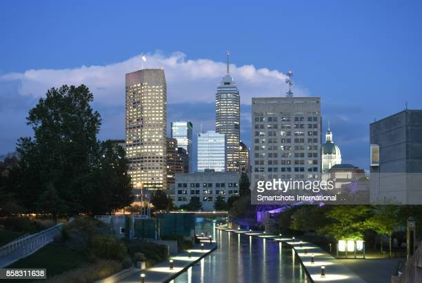 indianapolis skyline with several skyscrapers illuminated at dusk in indiana state, usa - indianapolis stock pictures, royalty-free photos & images