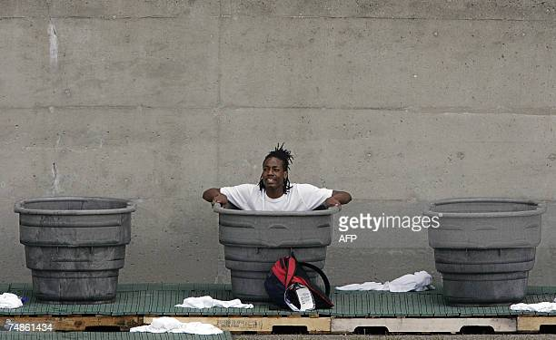 An athlete cools down in tubs full of ice during the 2007 ATT US Outdoor Track and Field Championships 22 June 2007 at Mike Carroll Stadium on the...