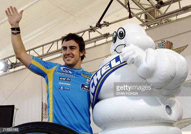 Formula One Renault driver Fernando Alonso of Spain with Bibendum the Michelin Tire Company mascot 29 June during preparations for the United States...