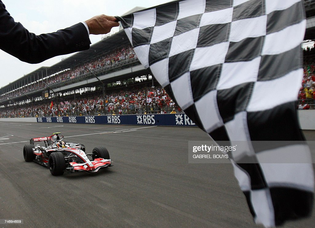 McLaren-Mercedes Formula One driver Lewis Hamilton of Britain crosses the finish line to win the United States Grand Prix at Indianapolis Motor Speedway in Indianapolis 17 June 2007. AFP PHOTO/Gabriel BOUYS