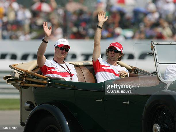 Toyota Formula One drivers Ralf Schumacher of Germany and Italian Jarno Trulli wave to the crowd before the United States Grand Prix at Indianapolis...