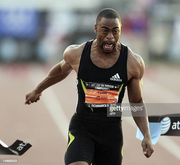 Indianapolis, UNITED STATES: Tyson Gay of the US crosses the finish line winning the Men's 100 Meter Dash during the 2007 AT&T US Outdoor Track and...