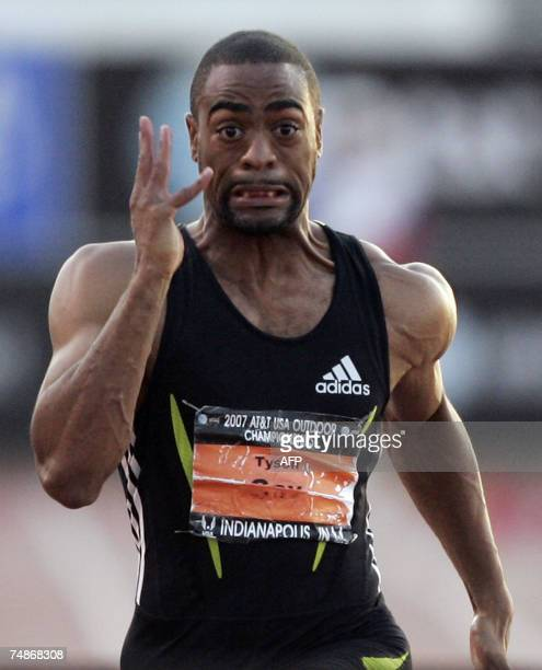 Indianapolis, UNITED STATES: Tyson Gay of the US heads to the finish line to win the Men's 100 Meter Dash during the 2007 AT&T US Outdoor Track and...