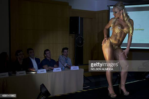 Indianara Carvalho from Santa Catarina state poses after winning the the Miss Bumbum Brazil 2014 pageant in Sao Paulo on November 17 2014 Carvalho a...