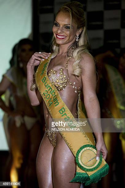 Indianara Carvalho from Santa Catarina state poses after winning the the Miss Bumbum Brazil 2014 pageant in Sao Paulo on November 17, 2014. Carvalho,...