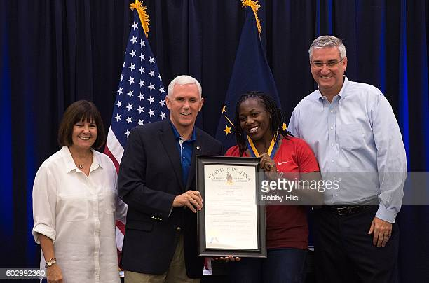 Indiana's First Lady Karen Pence, Gov. Mike Pence, Amber Campbell and Lt. Gov. Eric Holcomb pose for a photo during a ceremony honoring Olympians...