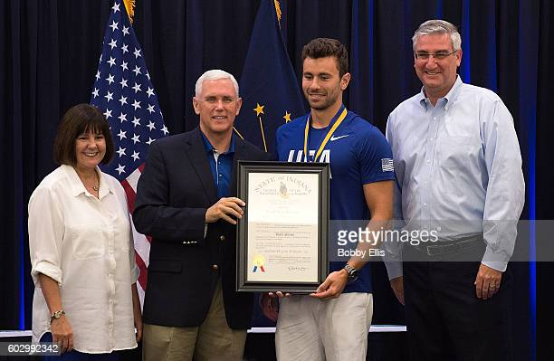 Indiana's First Lady Karen Pence, Indiana Gov. Mike Pence, Olympic swimmer Blake Pieroni and Indiana Lt. Gov. Eric Holcomb pose for a photo during a...