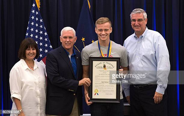 Indiana's First Lady Karen Pence, Indiana Gov. Mike Pence, Olympic diver Steele Johnson and Indiana Lt. Gov. Eric Holcomb pose for a photo during a...