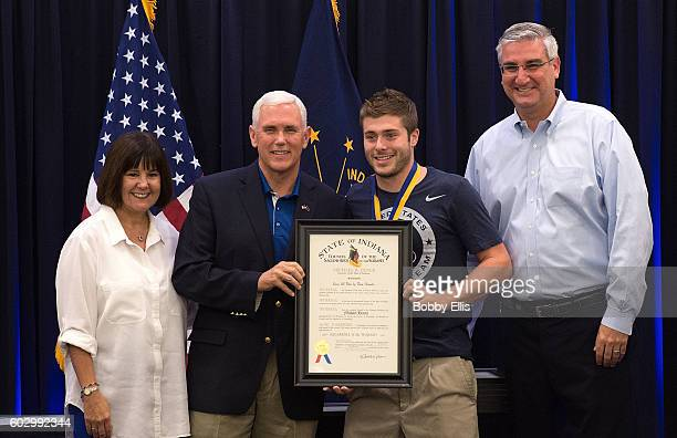 Indiana's First Lady Karen Pence, Indiana Gov. Mike Pence, Olympic diver Michael Hixon and Indiana Lt. Gov. Eric Holcomb pose for a photo during a...