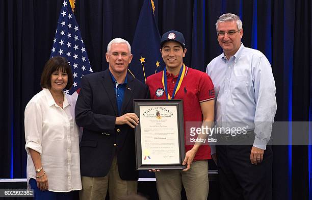 Indiana's First Lady Karen Pence, Indiana Gov. Mike Pence, Olympic fencer Gerek Meinhardt and Indiana Lt. Gov. Eric Holcomb pose for a photo during a...