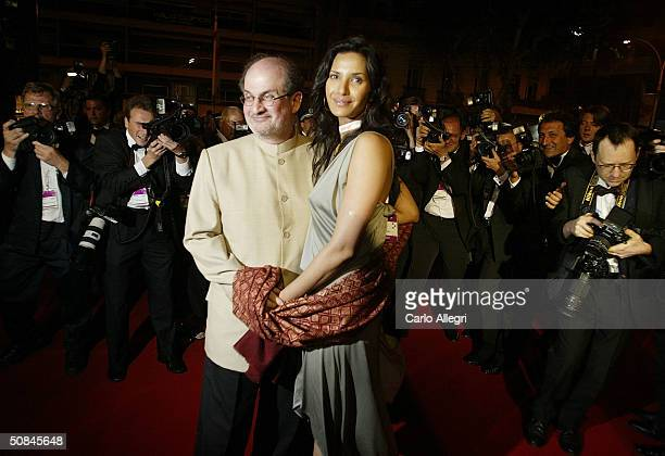 Indianborn author Salman Rushdie and wife Padma Lakshmi depart after the premiere of movie 'Comme Une Image' directed by Agnes Jaoui at the Palais...