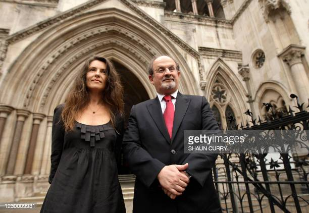 Indian-born author Sir Salman Rushdie and his former wife Elizabeth West pose for photographs outside the High Court in London, on August 26, 2008....