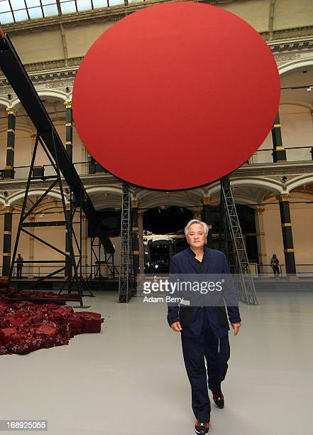 Indianborn British sculptor Anish Kapoor walks in front of his work 'Symphony for a Beloved Sun' prior to the opening of the 'Kapoor in Berlin'...