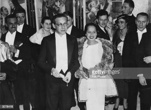 Indianborn film actress Merle Oberon and husband Hungarian born film producer Sir Alexander Korda at the opening night of 'The Private Life of Don...