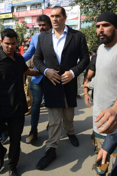 Indianborn US professional wrestler Dalip Singh Rana known as `The Great Khali` walks after attending a promotional event in Amritsar on January 24...
