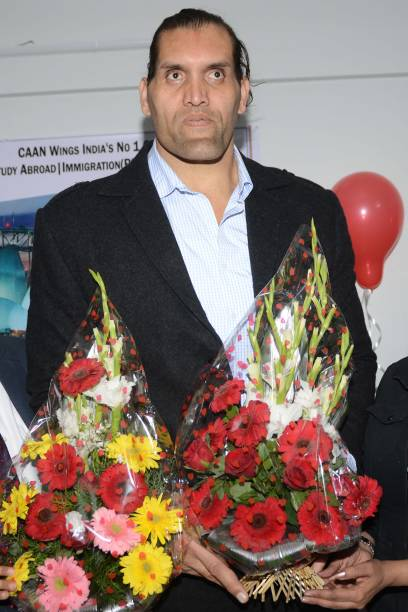 Indianborn US professional wrestler Dalip Singh Rana known as `The Great Khali` looks on during the opening ceremony of `Caan Wings Consultants` in...