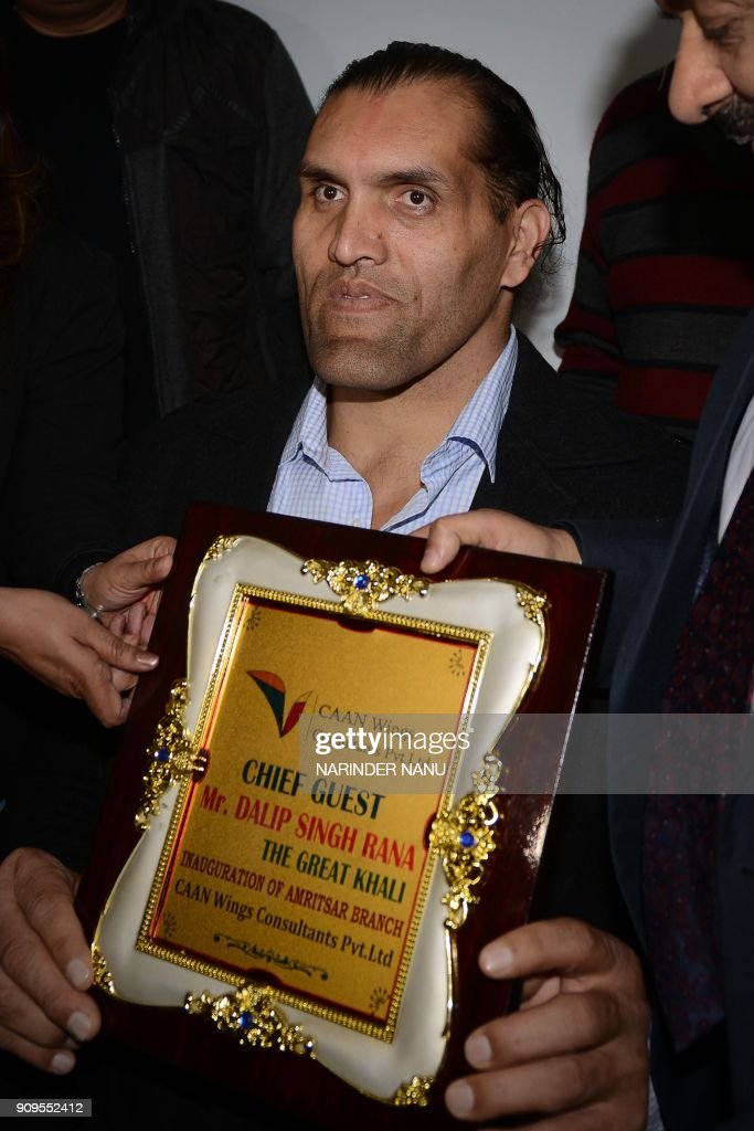 Indianborn US professional wrestler Dalip Singh Rana known as `The Great Khali` holds a momento during the opening ceremony of `Caan Wings...
