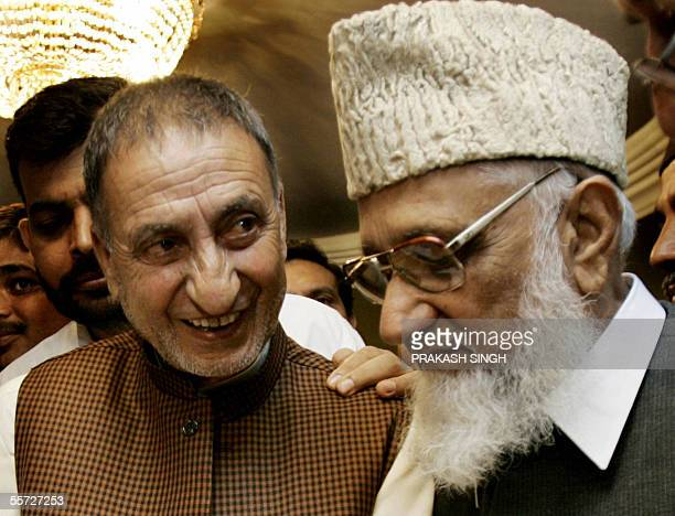 Indiancontrolled Kashmir separatist leader Abdul Ghani Bhatt talks with Supreme Head of the All JK Muslim Conference from Pakistancontrolled Kashmir...
