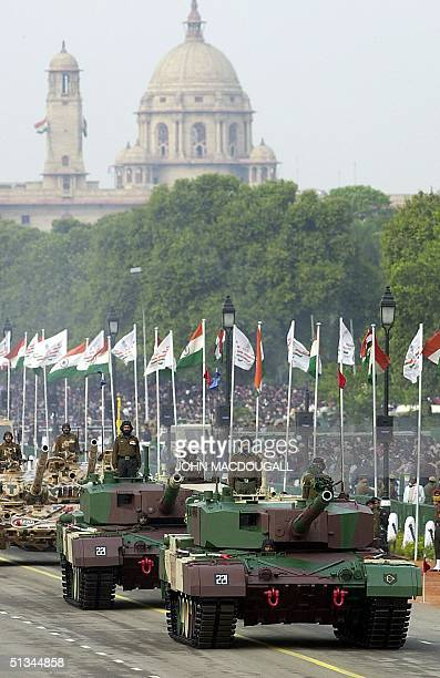 Indianmade Arjuna tanks make their way down the Rajpath in New Delhi during the country's 50th Republic Day parade 26 January 2000 India honoured its...