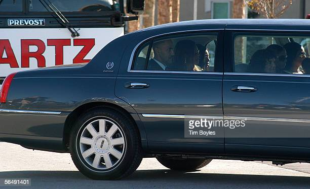 Indianpolis Colts head coach Tony Dungy and his family leave the funeral for his son James Dungy in the back of a car December 27 2005 in Tampa...