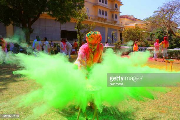 Indians and Foreigners tourist celebrating Holi Festival at City Palace in Jaipur Rajasthan India on 13 March 2017