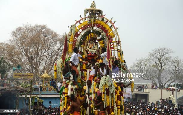 Indians and transgender devotees gather as Hindu priests take part in a ritual procession pulling the statue of warrior god Aravan on a charriot the...