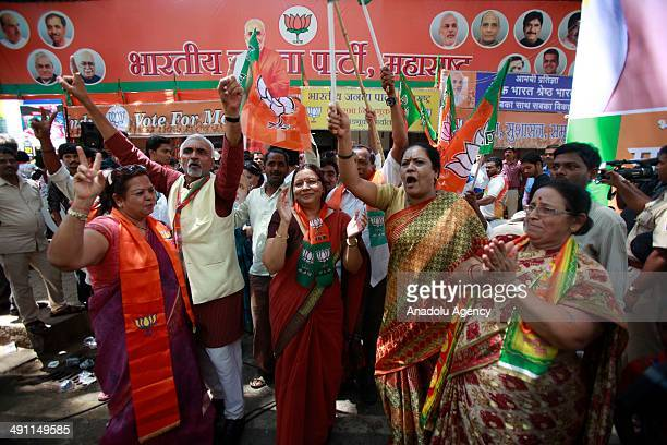 Indians celebrate after the favorite to be India's next prime minister Narendra Modi has won a seat in India's old temple city Varanasi on early...