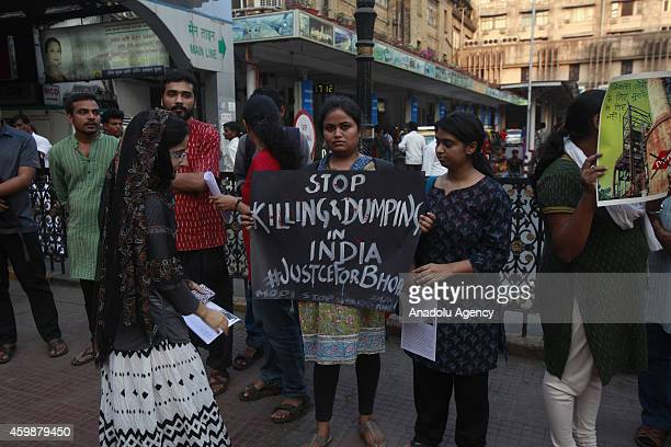 Indians hold banners during a demonstration held to mark the 30th anniversary of Bhopal gas tragedy in Mumbai on December 32014 The night of Dec 2...