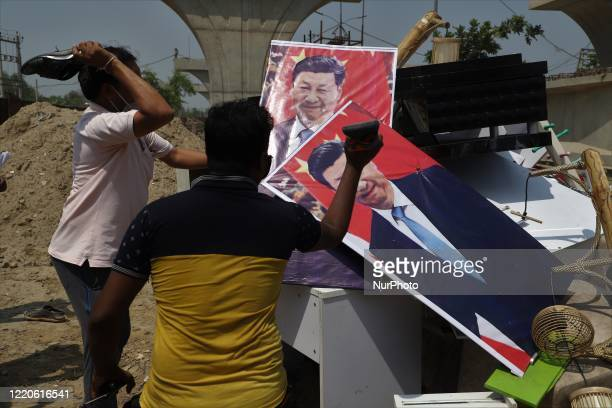 Indians Protesters hold placards and shout slogans during a protest against Chinese President Xi Jinping in Gurugram on the outskirts of New Delhi,...
