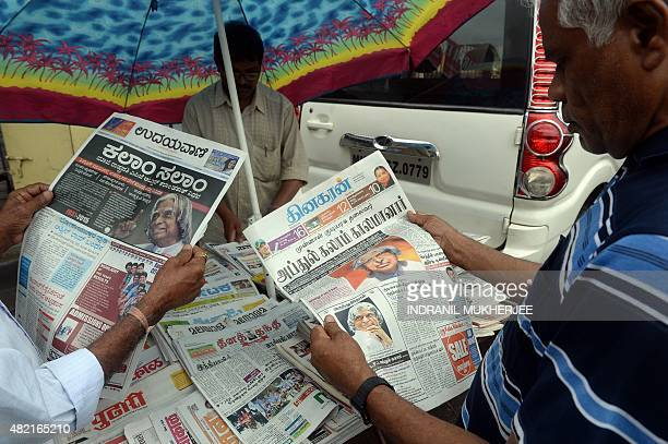 Indians read newspapers with the news of the demise of India's former president and top scientist A P J Kalam at the age of 83 on their front pages...