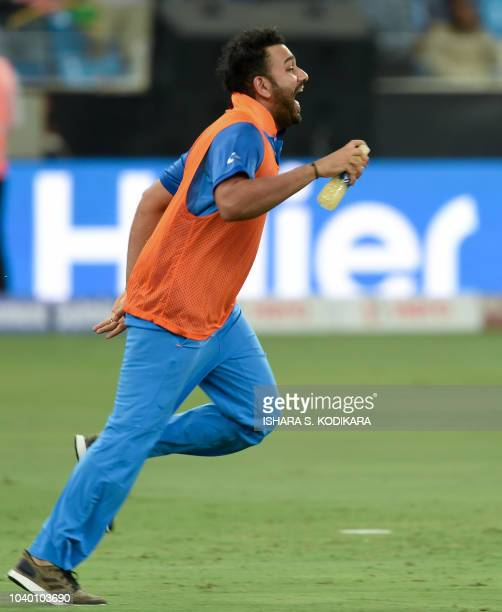 Indian's Rohit Sharma run during the one day international Asia Cup cricket match between Afghanistan and India at the Dubai International Cricket...