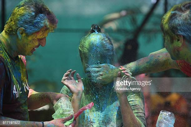 Indians take part in the Holi Festival celebrations in Mumbai India on March 24 2016 Holi the festival of colors is a riotous celebration of the...