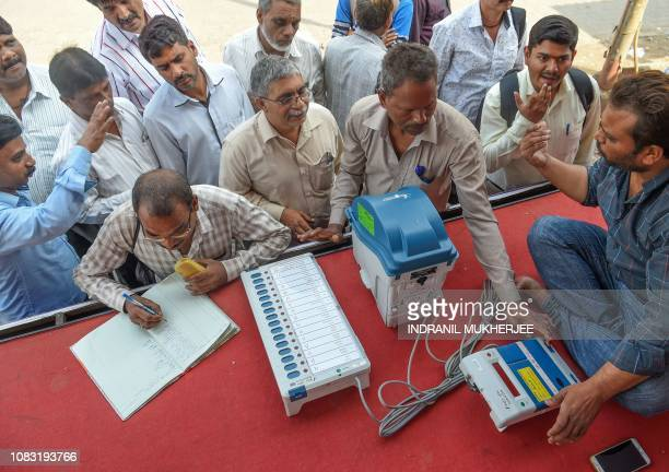 Indians try out the Electronic Voting Machine in conjunction with the VoterVerified Paper Audit Trail a ballotless voting system at an Election...