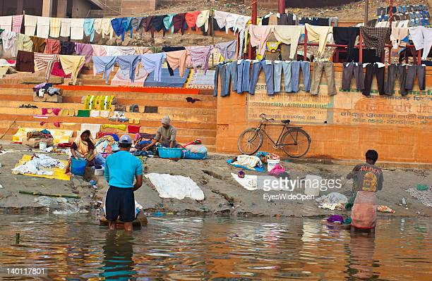 Indians wash laundry with their hands in the Ganges river and dry it on clothes lines at Dhobi Ghat a well known open air laundromat on February 1...