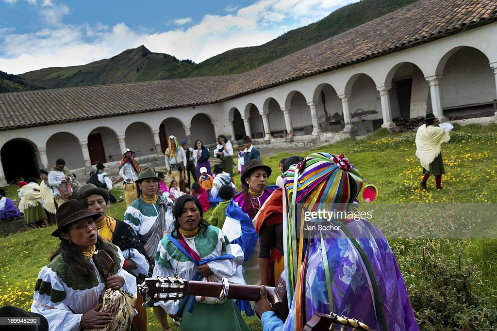 "Indians, wearing colorful costumes, dance and sing in a former monastery garden during the Inti Raymi festival on 26 June 2010 in the village of Pesillo, Ecuador. Inti Raymi, ""Festival of the Sun"" in Quechua language, is an ancient spiritual ceremony held in the Indian regions of the Andes, mainly in Ecuador and Peru. The lively celebration, set by the winter solstice, goes on for various days. The highland Indians, wearing beautiful costumes, dance, drink and sing with no rest. Colorful processions in honor of the God Inti (Sun) pass through the mountain villages giving thanks for the harvest and expressing their deep relation to the Mother Earth (Pachamama)."