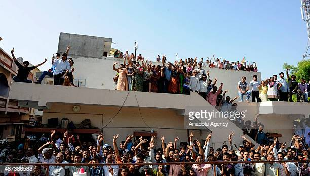 Indians welcome Narendra Modi prime ministerial candidate of Indias main opposition Bharatiya Janata Party when he arrives to cast his vote at the...