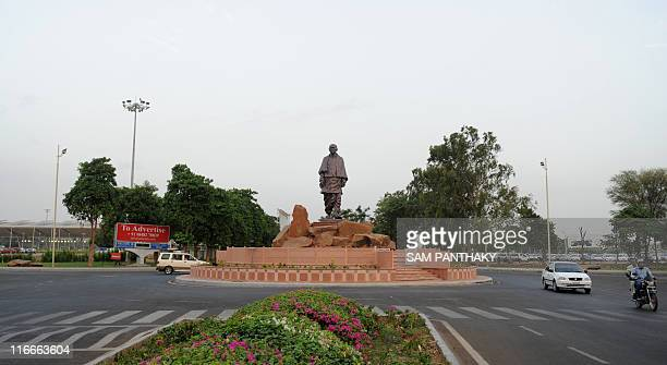 STORY 'Indiapoliticsstatue' by Abhaya Srivastava Indian commuters circle a roundabout where a statue of 'Iron Man of India' Sardar Vallabhbhai Patel...
