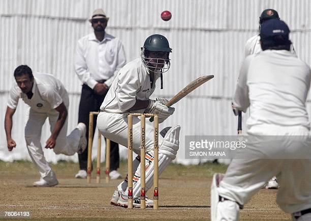 India's A bowler Irfan Pathan looks as Kenya's batsman Hiren Varaiya duck a delivery 12 August 2007 at the Mombasa Sports Club during their thirdday...
