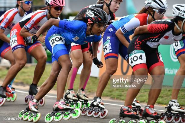 India's Aarathy Kasturi Raj competes in the women's roller skate road 20km race final during the 2018 Asian Games in Palembang on August 31 2018