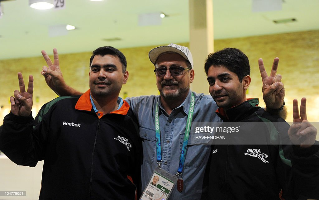 India's Abhinav Bindra (R) and Gagan Narang (C) pose with their coach Stanislav Lapidus (C) flashing the victory sign after they won gold in the men's Pairs 10m Air Rifle shooting event at the XIX Commonwealth Games in New Delhi on October 5, 2010.