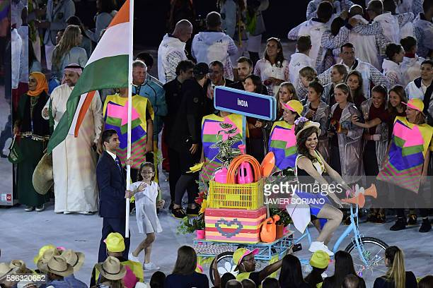 India's Abhinav Bindra carries their country's flag as they lead teammates into the stadium during the opening ceremony of the Rio 2016 Olympic Games...