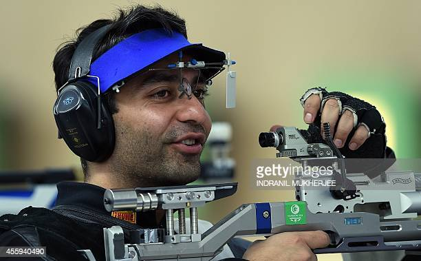 India's Abhinav Bindra reacts after a shot during the men's 10m air rifle event at the Ongnyeon International shhoting range of the 2014 Asian Games...