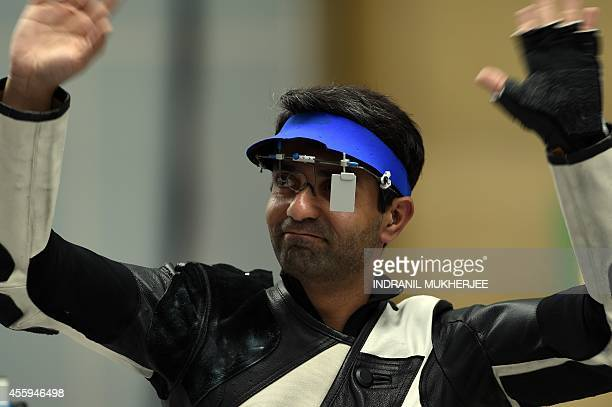India's Abhinav Bindra reacts after winning the bronze medal in the men's 10m air rifle individual event at the Ongnyeon International shooting range...