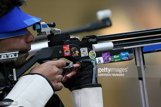 India's Abihinav Bindra competes in the 10m Air Rifle men qualifying round at the Royal Artillery Barracks in London on July 29 2012 during the...