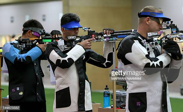 India's Abihinav Bindra competes in the 10m Air Rifle men qualifying round at the Royal Artillery Barracks in London on July 30 2012 during the...