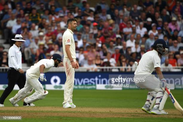 India's Ajinkya Rahane and India's captain Virat Kohli run between the wickets as England's James Anderson looks on during the third day of the third...