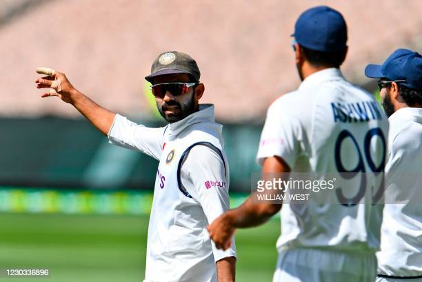India's Ajinkya Rahane directs his players on the fourth day of the second cricket Test match between Australia and India at the MCG in Melbourne on...