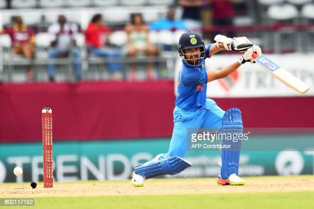 India's Ajinkya Rahane plays a shot during the first One Day International match between West Indies and India at the Queen's Park Oval in Port of...