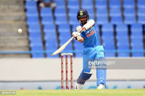 India's Ajinkya Rahane plays a shot during the third One Day International match between West Indies and India at the Sir Vivian Richards Cricket...
