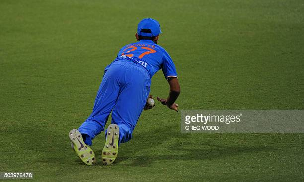 TOPSHOT India's Ajinkya Rahane takes an outfield catch which was given disallowed during the T20 cricket match between India and a Western Australian...